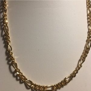 A gold Figaro necklace